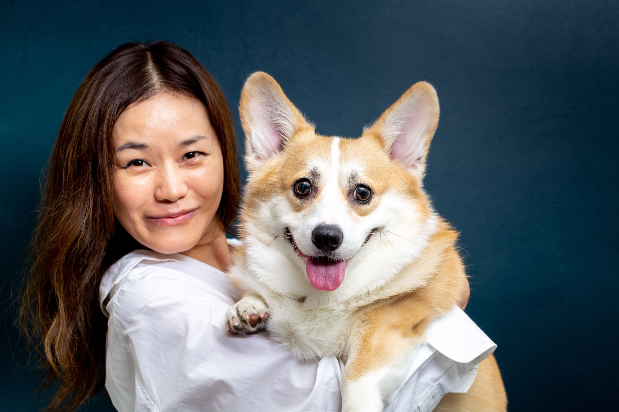 Pet Insurance: Dog In Veterinarian's Arms