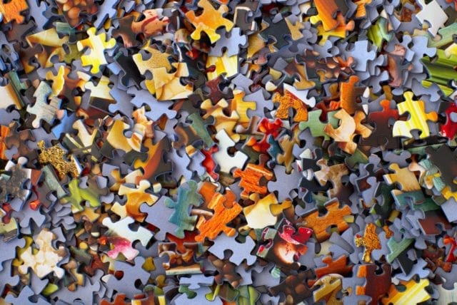 up close image of colorful jigsaw puzzle pieces